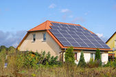 Solar panels installed on the roof of the house — Stock Photo