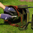 Cleaning lawn mower — Stock Photo