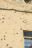 Holes in the wall of bullets — Stock Photo