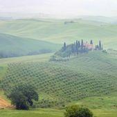 Tuscany house in fog — Stock Photo