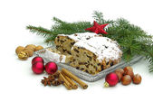 Christmas cake decorated with fir branches with Christmas toys — Stock Photo