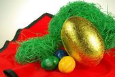 Easter eggs on red — Stock Photo