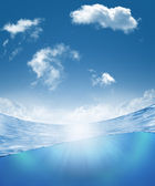 Underwater part and skylight splitted by waterline — Stock Photo