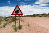 Elephant crossing sign on a gravel road — Stock Photo