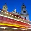 Moving red bus in front of St. Paul cathedral — Stock Photo #47993147
