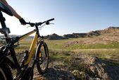 Bicycle among hills — Stock Photo
