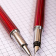 Two pens on a notebook close up - Stock Photo