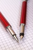 Two pens on a notebook close up — 图库照片