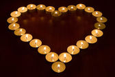 candles in the shape of heart — Stock Photo