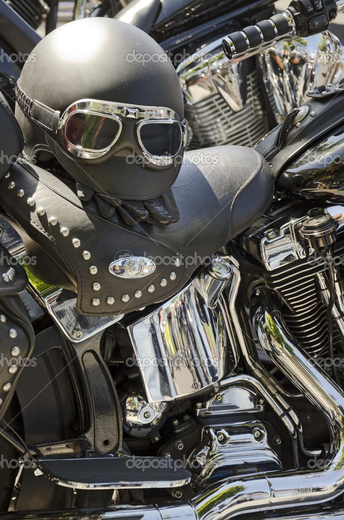 Black motorcycles with black leather seats and helmet and chrome parts  Stock Photo #12660542