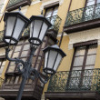 Stock Photo: Lampposts and Balconies