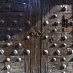 Old wooden door with metal rivets — Stock Photo #20026515