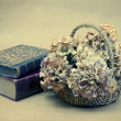 Still life with books and flowers — Stock Photo