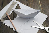 Making paper boats — Stock Photo