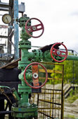 Pump jack and oil well — Stock Photo