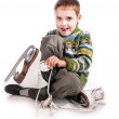 Boy with skates, insulated background — Stock Photo