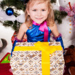Girl holding a gift — Stock Photo #16297883