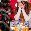 Girl with gifts near a Christmas tree — Φωτογραφία Αρχείου