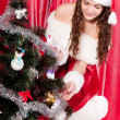 Girl with gifts near a Christmas tree — Stock Photo #16298521