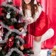 Girl with gifts near a Christmas tree — Foto de Stock