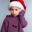 Girl in a Christmas hat — Stock Photo