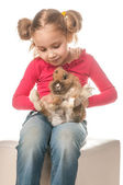 Little girl playing with Easter bunny on a white background — Stock Photo