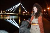 Girl standing on the night bridge — Stock Photo