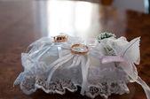 Wedding rings on a cushion — Stock Photo