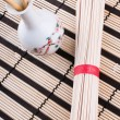 Chinese noodles on the mat — Stock Photo