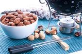 Chocolate fondue with nuts — Stock Photo