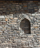 Part of a house built their stone wall — Stock Photo