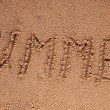 The Word Summer Written in the Sand on a Beach with Drawing of the Sun — Stock Photo