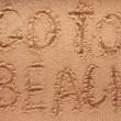 Slogan on a sand. go to beach. — Foto de Stock