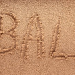 Stock Photo: Word Bali outline on wet sand with wave brilliance - holiday concept