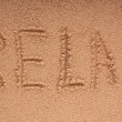 Word Relax on beach - vacation concept background — Stock Photo