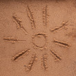 Stock Photo: Sun sign on sebeach