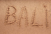 Word Bali outline on the wet sand with the wave brilliance - holiday concept — Stock Photo