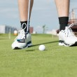 Golf ball on green grass prepare for putting — Stock Photo #30907445