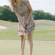 Full length view of 5 year old girl swinging golf club. — Стоковая фотография