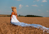 Adorable little girl playing in the wheat field — Stock Photo
