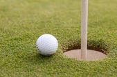 Golf ball on green grass, selective focus — Stock Photo