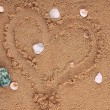 Heart drawing in the sand on the beach — Stock Photo
