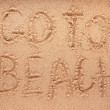 Slogan on a sand. go to beach. — Stok fotoğraf