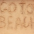 Slogan on a sand. go to beach. — Stockfoto