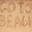 Slogan on a sand. go to beach. — ストック写真