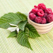 Fresh raspberries with mint in a bowl — Stock Photo