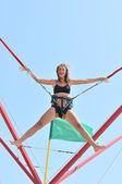 Jumping girl on the trampoline — Foto de Stock
