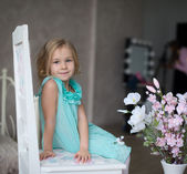 Laughing little girl looking — Stock Photo