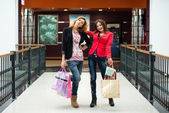 Three beautiful girls with shopping — Stockfoto