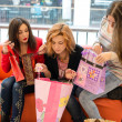 Stock Photo: Three beautiful girls with shopping